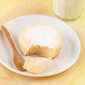 Broken Sweet Sugar Milk Cake on a white plate — Stock Photo