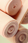 Elastic bandage roll for first aid. — Stock Photo