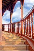 Old teak wood outdoor spiral staircase. — Stock Photo