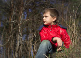 Boy in jacket looking into the distance — Stock Photo