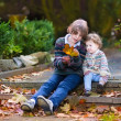 Brother and his little baby sister in a beautiful autumn park — Stock Photo