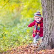 Little baby girl in a sunny autumn park — Stock Photo