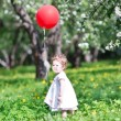 Baby girl playing with a big red balloon — Stock Photo #43241683
