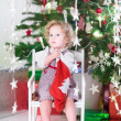 Toddler girl checking her Christmas stocking — Stock Photo #43241807