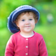 Little girl in a big knitted hat — Stock Photo #43242797