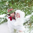 Boy hugging his baby sister in winter park — Stock Photo #43242895