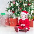 Cute little toddler girl in a Santa hat — Stock Photo