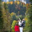 Father showing his two kids the Neuschwanstein Castle — Stock Photo