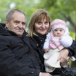 Great-grandfather, grandmother and little baby girl in the park — Stock Photo #43244827