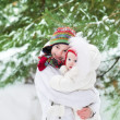 Boy hugging his baby sister in winter park — Stock Photo