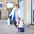 Mother and her toddler daughter enjoying shopping — Stock Photo