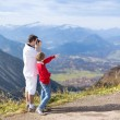 Father and his teenager son taking pictures of a beautiful valley — Stock fotografie