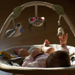 Newborn baby girl sleeping in a bouncer chair — Stock Photo