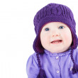 Baby girl wearing a purple sweater and knitted hat — Stock Photo #43246677