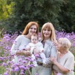 Four generations of women in a field — Stock Photo
