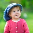 Girl wearing a big knitted hat — Stock Photo #43247479