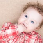 Baby girl sucking on her finger — Stock Photo
