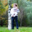 Brother and baby sister in a park — Stock Photo #43248083