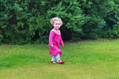 Baby girl playing in the garden — Stock Photo
