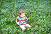 Baby girl relaxing on the lawn — Stock Photo