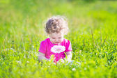 Girl playing in the garden — Stock Photo