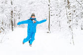 Boy playing with snow in a winter park — Photo