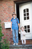 Brother and baby sister first day go to school and kindergarten — Stock Photo