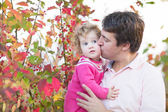 Father kissing his cute baby daughter — Stock Photo
