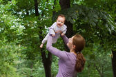 Mother playing with a laughing baby girl — Stock Photo