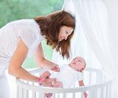 Mother putting her newborn baby to sleep — Stock Photo