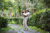 Brother and sister in a park — Stock Photo