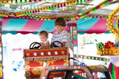 Brother and sister in an amusement park — Stock Photo