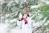 Child playing snow ball — Stock fotografie