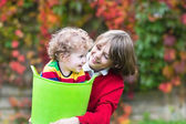 Happy laughing brother and baby sister playing together — Stock Photo