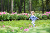 Baby girl running in the  park — Stock Photo