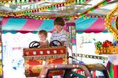 Boy and his baby sister enjoying amusement park — Stock Photo