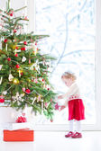 Toddler girl decorating Christmas tree — Stock Photo