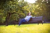 Pregnant woman enjoying the sunset in an autumn park — Stock Photo