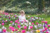 Adorable baby girl playing in a garden — Stock Photo