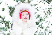 Little baby sitting in fresh snow — Stock Photo