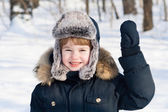 Funny boy in a fur hat — Stock Photo