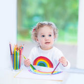 Happy laughing toddler girl drawing — Photo