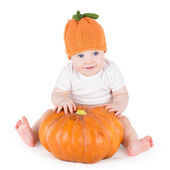 Baby playing with a big pumpkin — Stock Photo