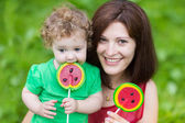 Mother and her daughter eating candy — Stock Photo