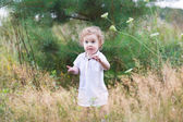 Baby girl playing in a heath park — Stock Photo