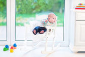 Newborn baby boy in a white rocking chair — Foto de Stock
