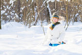 Child playing in a snow field — Stock Photo