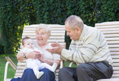 Grandparents playing with a little baby — Stock Photo