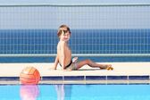 Boy playing at the swimming pool — Stock Photo