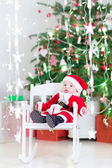Baby boy in Santa costume — Photo